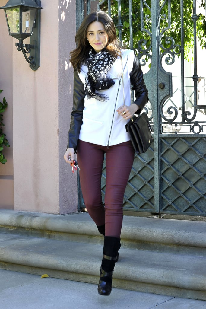 Emmy Rossum was right on trend in her wine-colored Old Navy coated denim ($29, originally $37), two-tone jacket, and printed scarf while out in LA.