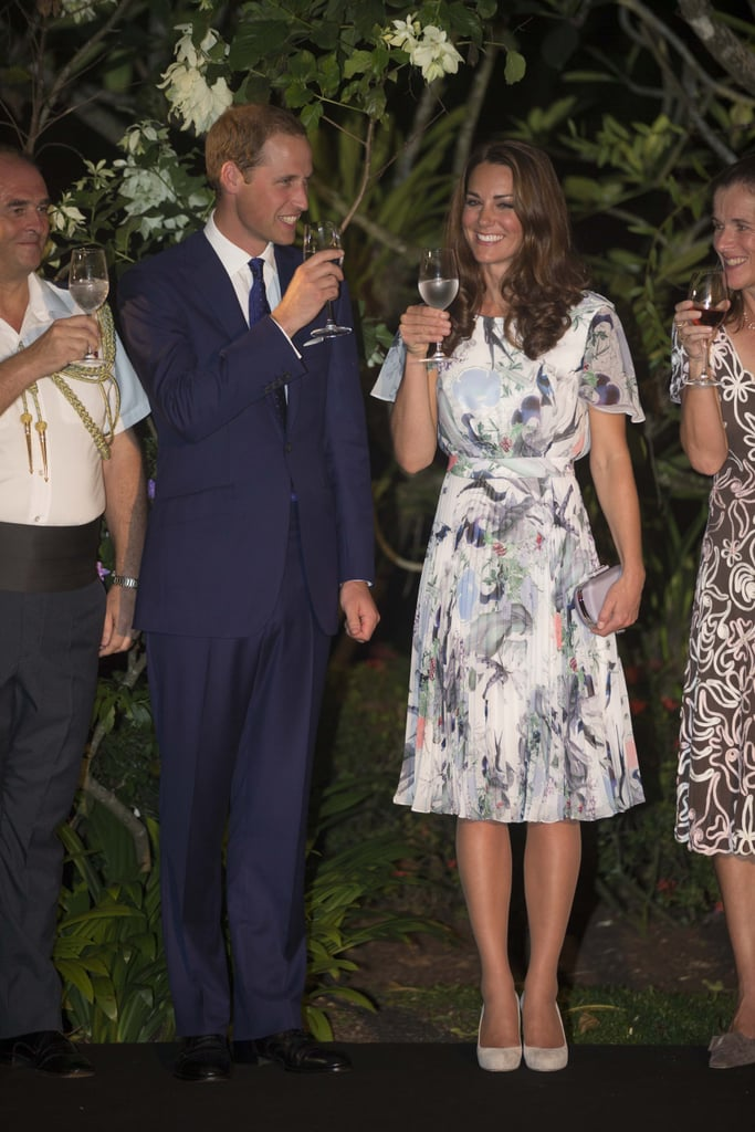 Prince William and Kate Middleton saluted each other with their glasses while in Singapore in September 2012.