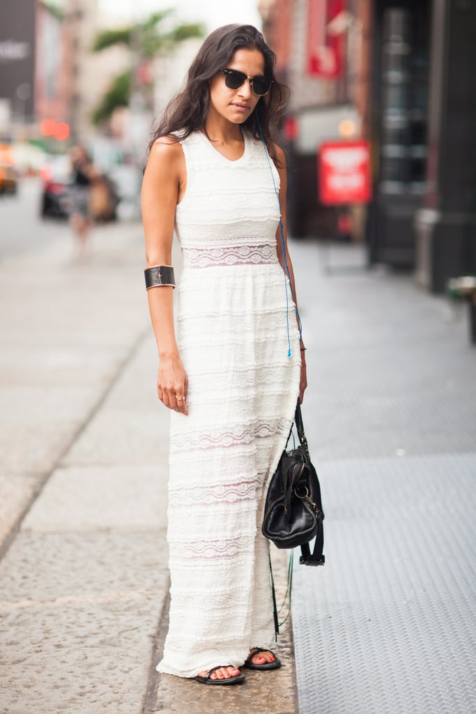 This white maxi scores extra points with semisheer detailing and sleek black accessories for contrast. Source: Le 21ème | Adam Katz Sinding