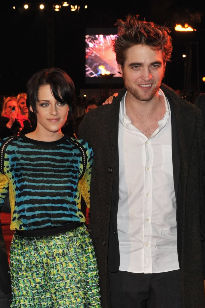 Kristen Stewart leaned on Robert Pattinson in her Proenza Schouler outfit at a New Moon UK fan event in November 2009.