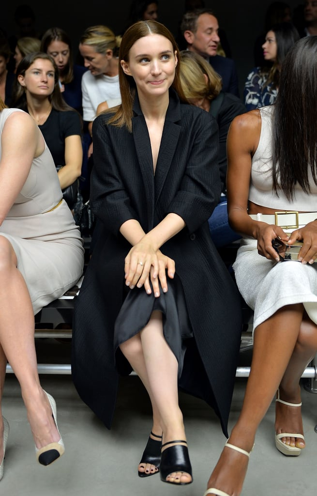 Rooney Mara took a darker approach while sitting front row at Calvin Klein Collection. She paired an oversized black collared coat with a silky skirt, then finished with strappy sandals.
