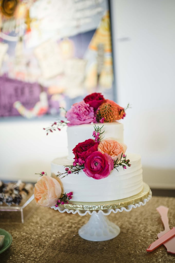 A soft texture on the base layer of this cake and the multitoned flowers are the perfect amount of detail to make this a beautiful dessert without going over the top.