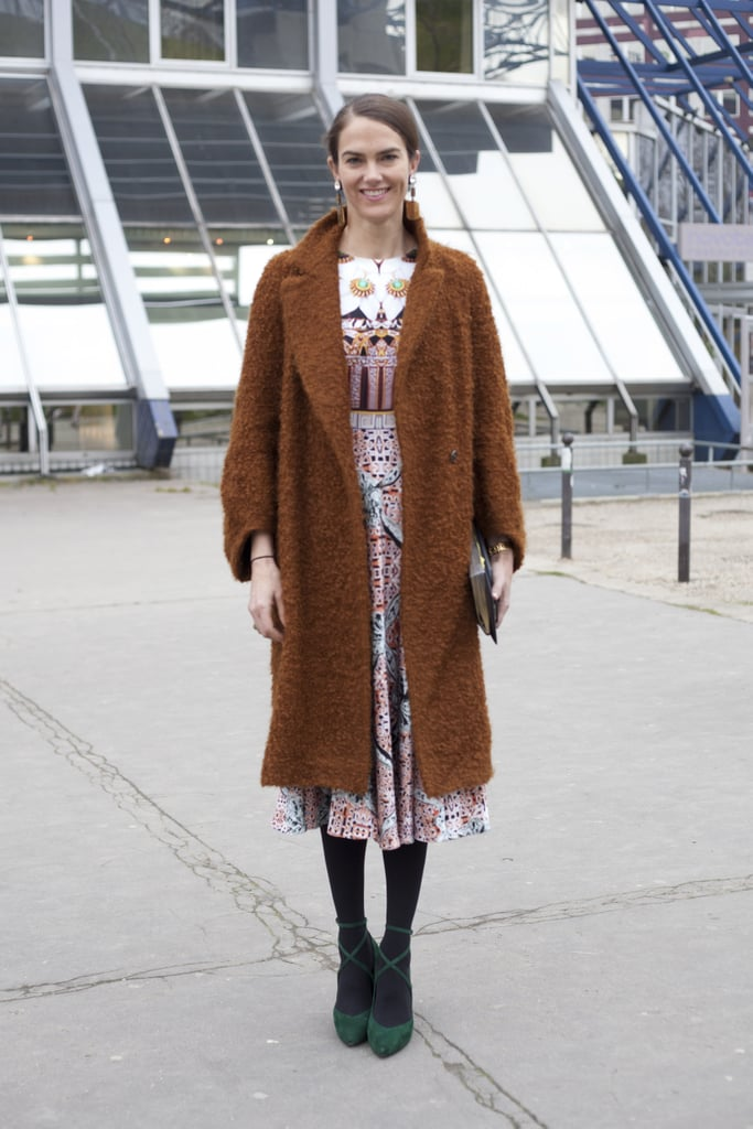 We love the juxtaposition of long bouclé coat against a pretty print and strappy heels.