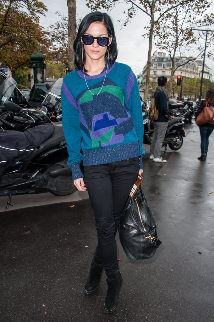 Leigh Lezark added a cool pair of chain sunglasses to her sweater-and-pant look for the Miu Miu show.