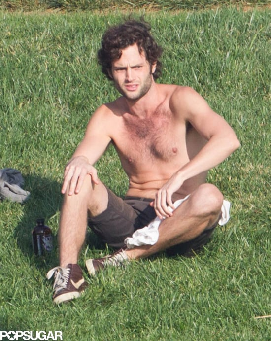 """Penn Badgley embraced the """"no shirt, no problems"""" philosophy when he hung out with friends at Echo Park in LA on Sunday."""