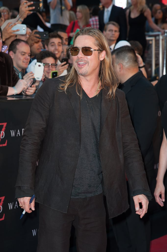 """Brad Pitt revealed Maddox's role in World War Z at the NYC premiere of the film:  """"He's got a small piece in it. He's a zombie who then gets shot. I don't know what that says about my parenting!"""""""