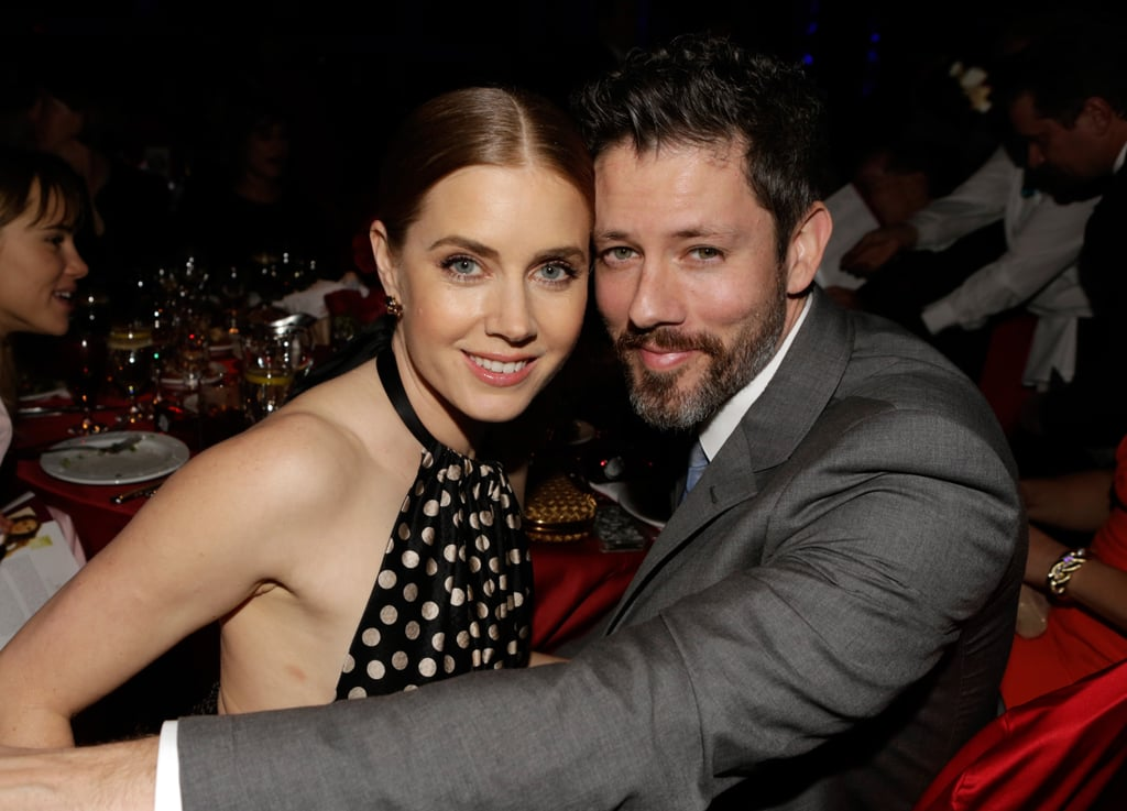Amy Adams and Darren Le Gallo kept close at their dinner table.