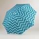 World Market's Blue Chevron Beach Umbrella ($17) is so chic in aqua and orange!