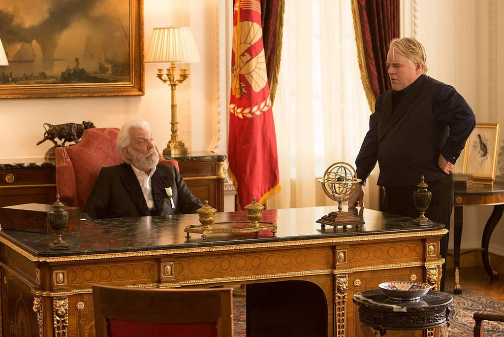 Donald Sutherland as President Snow and Philip Seymour Hoffman as Plutarch Heavensbee in Catching Fire.