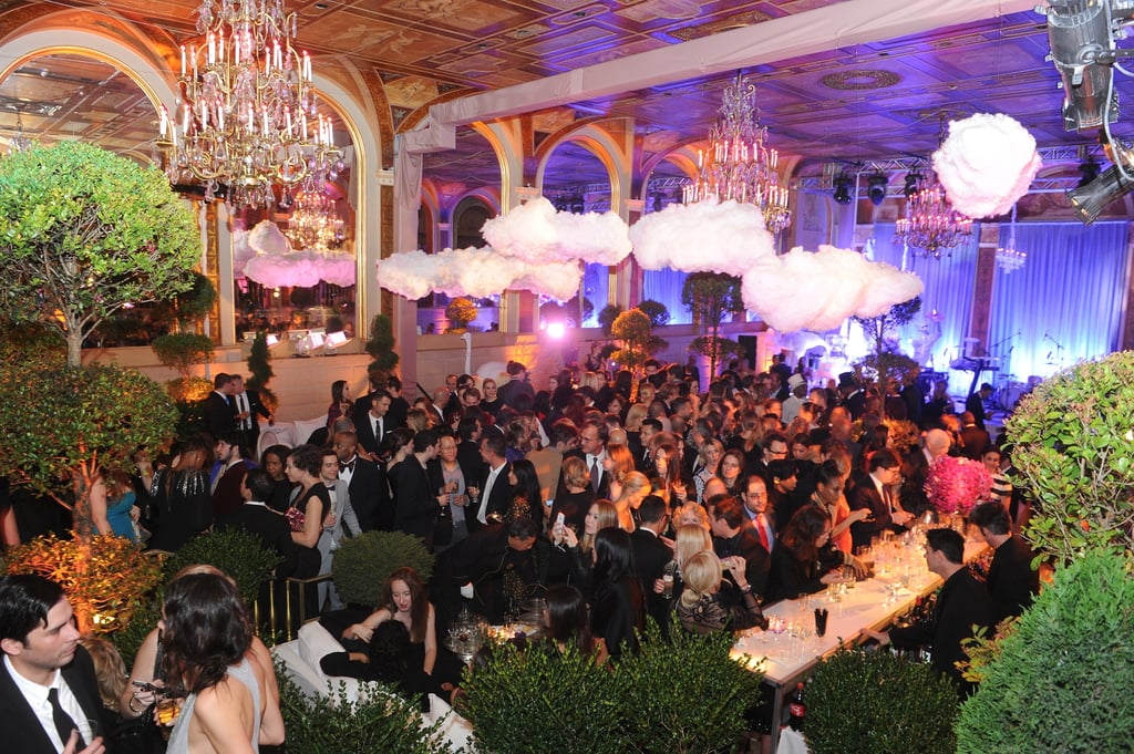 An aerial view of the scene at The Plaza Hotel — fluffy clouds, pink chandeliers, and gorgeous greenery.