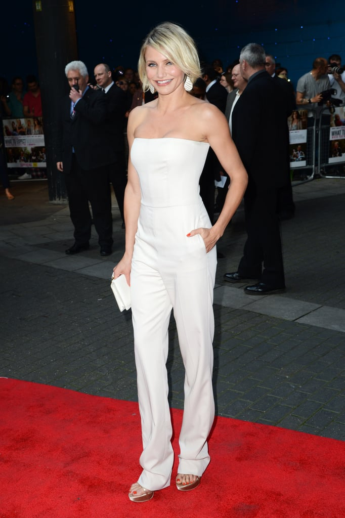 Cameron Diaz lit up the carpet in a one-piece white pantsuit at the What to Expect When You're Expecting premiere.