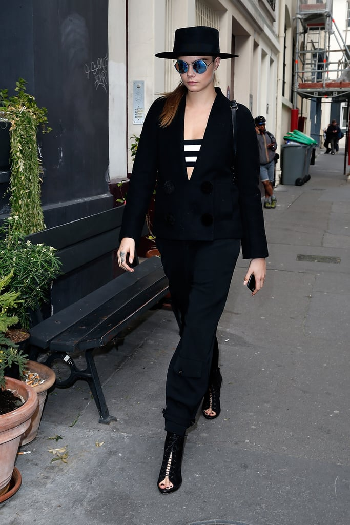 Cara Delevingne added a hint of sexiness to her black jumpsuit with a striped bandeau.