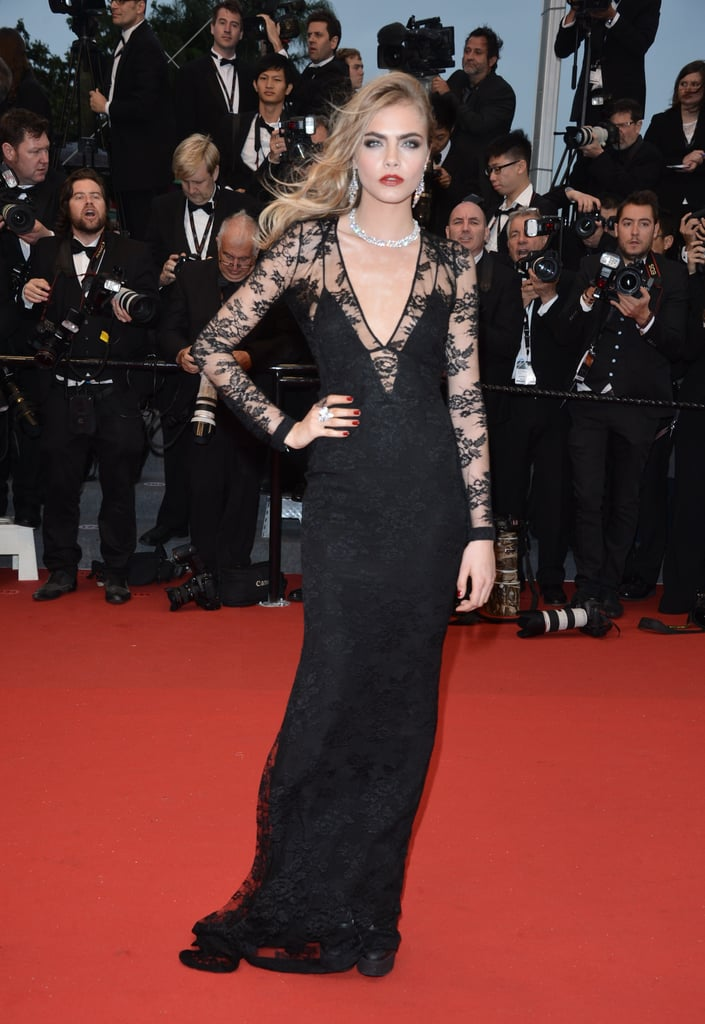Cara Delevingne ditched the layers and got majorly glam in a black lace gown and diamonds at the Great Gatsby premiere at Cannes.