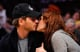 Drew Barrymore locked lips with Will Kopelman during a visit to LA's Staples Center in April 2011.