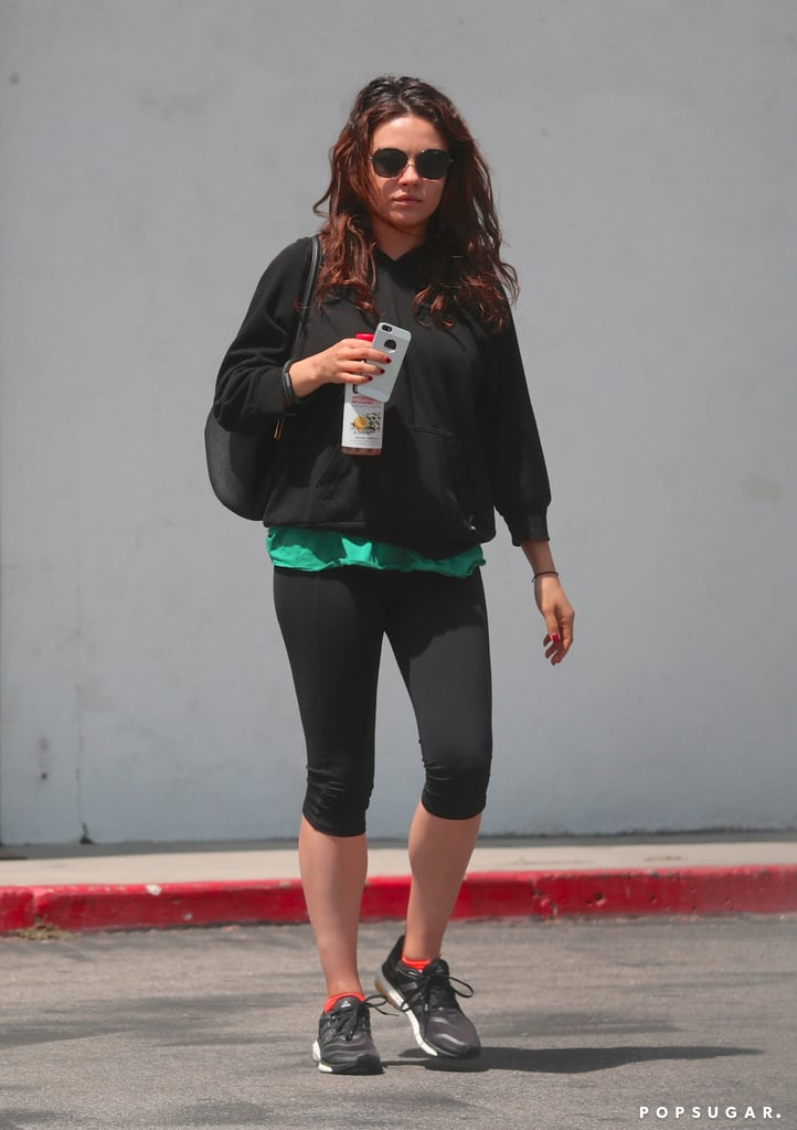 Pregnant Mila Kunis Squeezes In a Workout