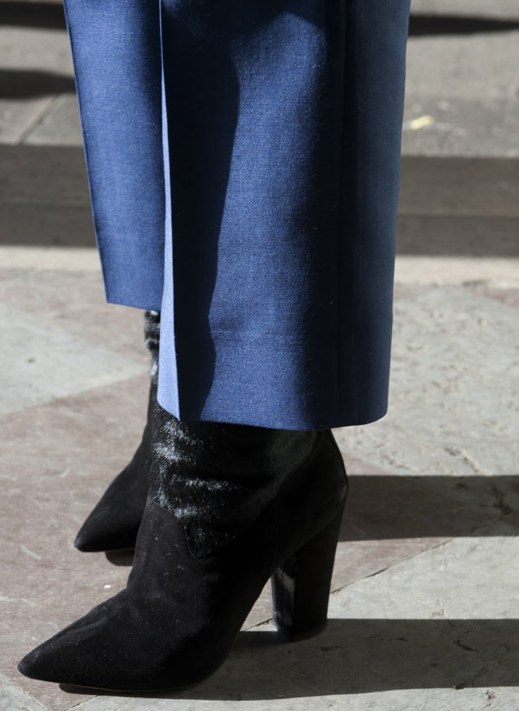 Black boots provided sharp contrast against blue trousers.