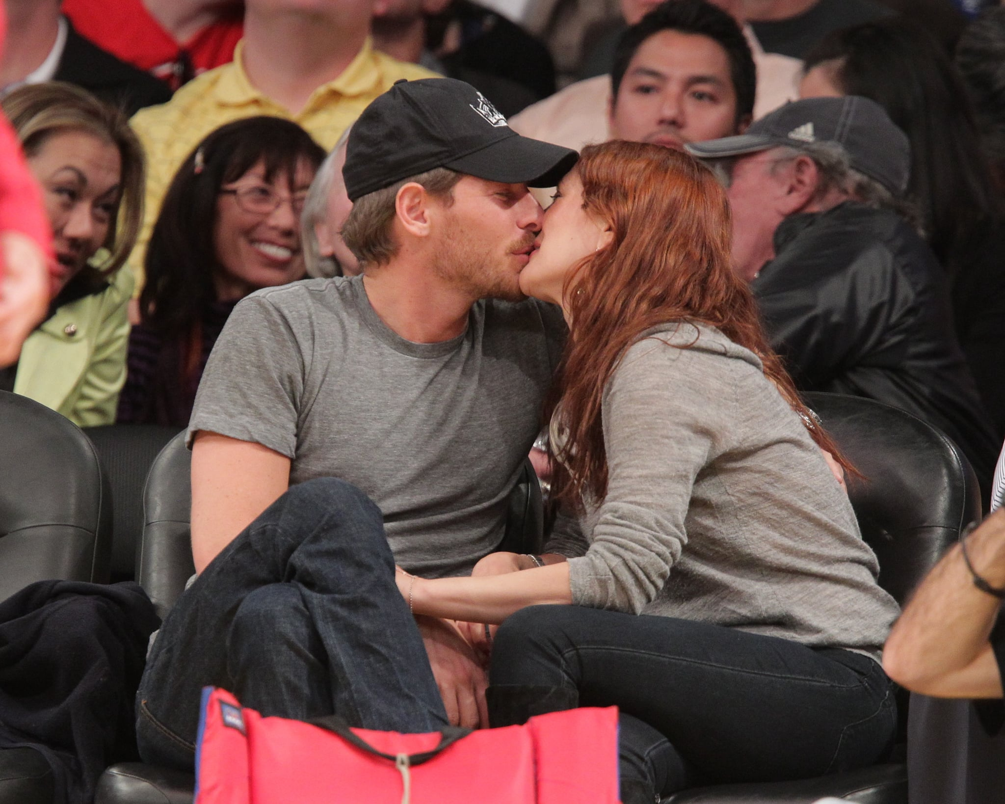 Drew Barrymore and Will Kopelman smiled while they kissed for the camera at the Lakers game.
