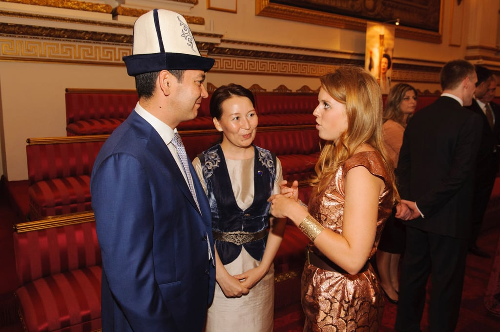 Princess Beatrice chatted with Prime Minister of Kyrgyzstan Omurbek Babanov and Rita Birbaeva during the Olympic reception at Buckingham Palace.