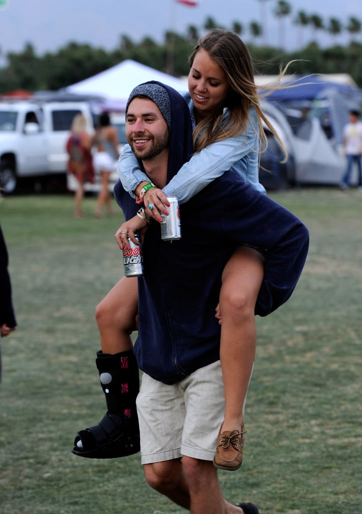 A guy gave his lady friend a ride at Coachella in Indio, CA.