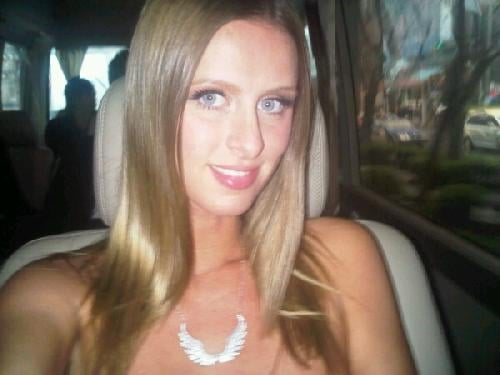 Nicky Hilton loves her necklace in Shanghai.