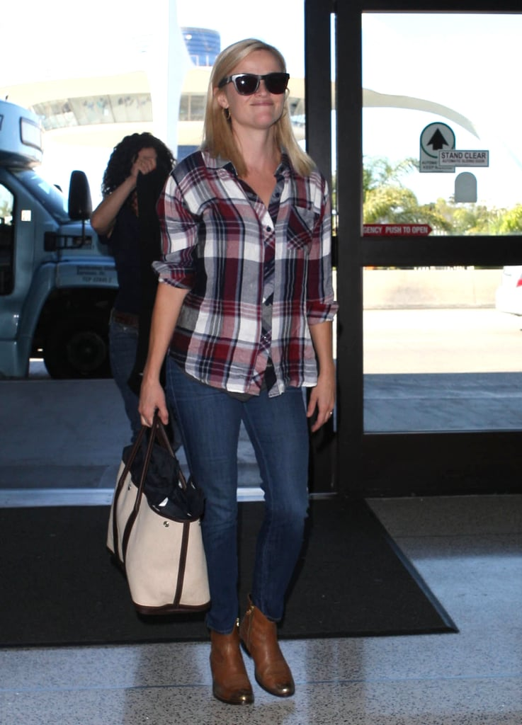 Channeling her Sweet Home Alabama roots in a plaid Rails button-down and cool-girl Golden Goose while catching a flight at LAX.