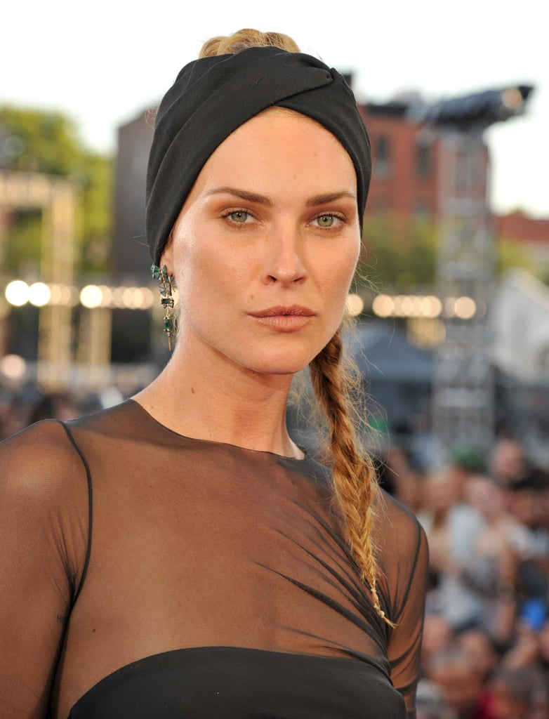 Erin Wasson pulled her hair back into a tousled braid, which she topped with a black turban headband.