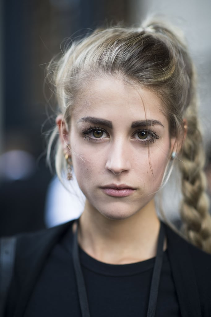 This braided ponytail puts Rapunzel to shame, and we can't get enough of this street stylers bold brows, too.  Source: Le 21ème | Adam Katz Sinding