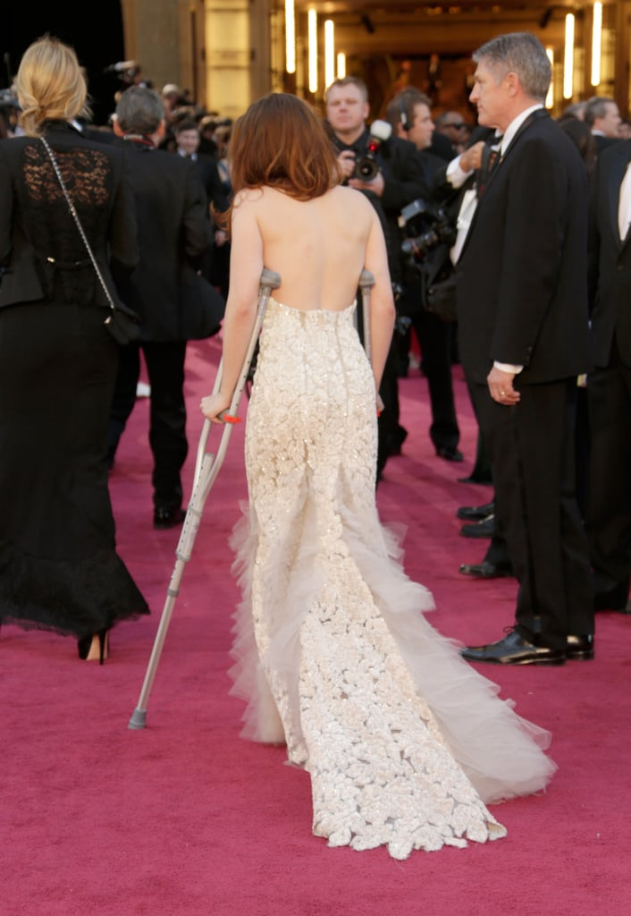 Kristen Stewart arrived on the Oscars red carpet on crutches.