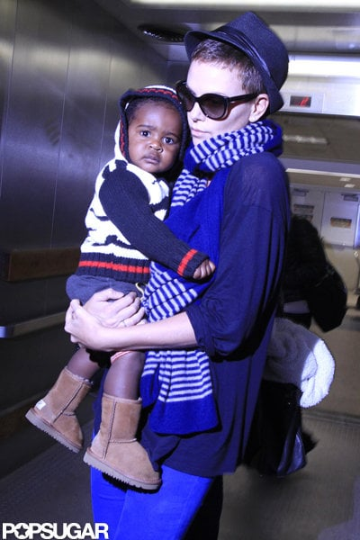 Charlize Theron exited the plane with Jackson Theron in her arms.