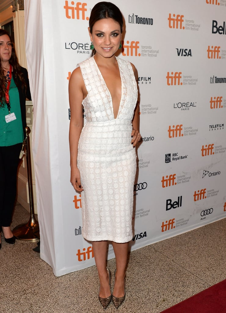 Mila Kunis took the plunge in a white fitted dress at the Third Person premiere.