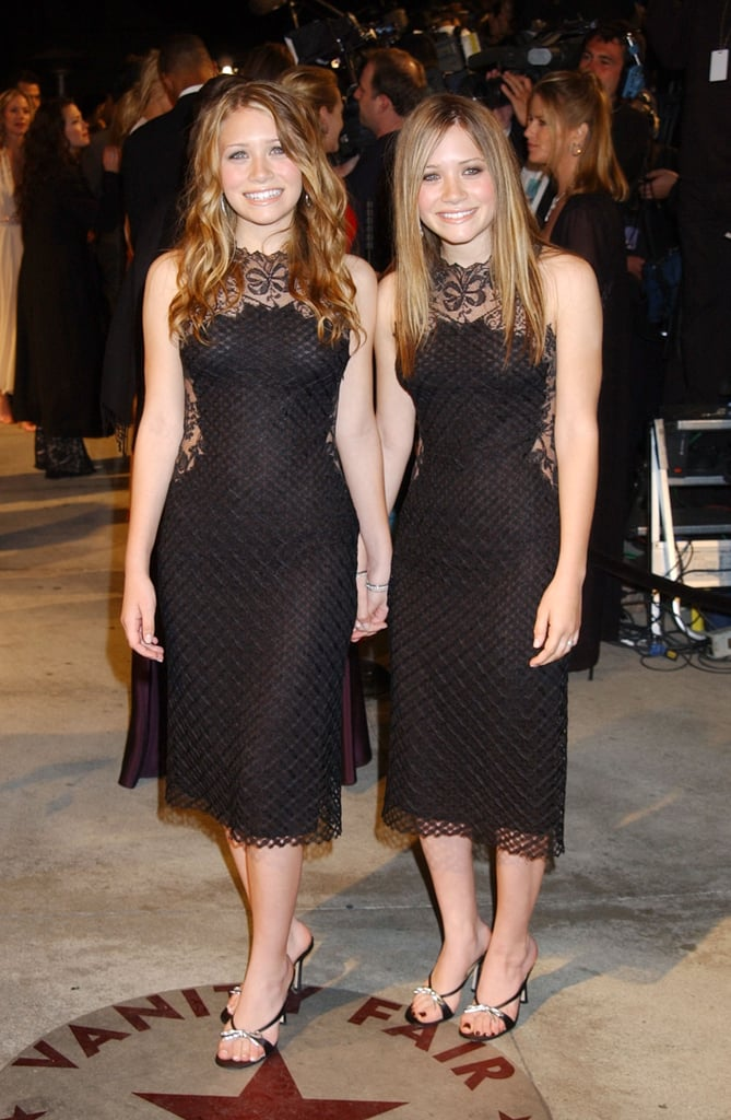 Twinning combo: You would have to be blind to miss the coordination the girls had going for Vanity Fair's 2002 Oscars party.  Ashley posed in a sleeveless lace-overlay sheath, crystal-accented sandals, and matching bangles. Mary-Kate was all smiles in the exact same ensemble.
