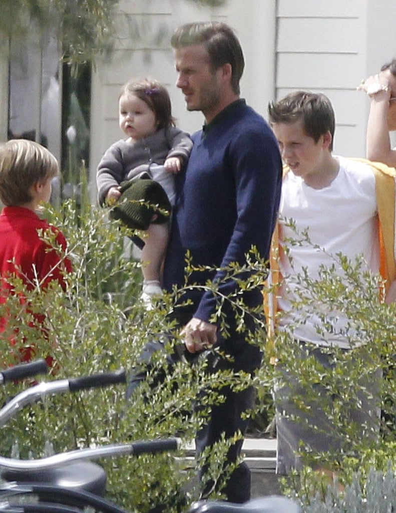 David Beckham held onto Harper for a family outing for Easter.
