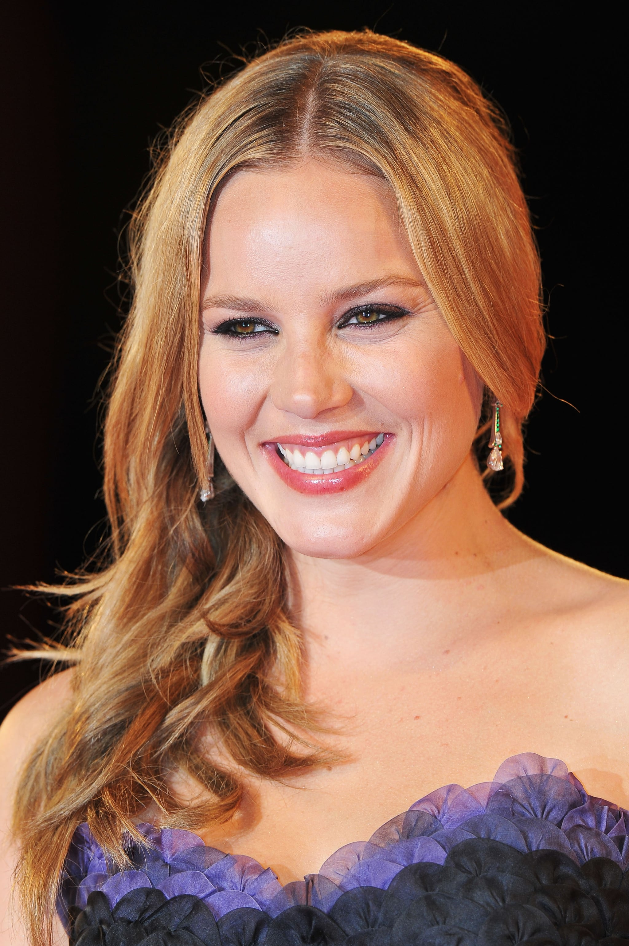 Abbie Cornish all smiles on the red carpet.