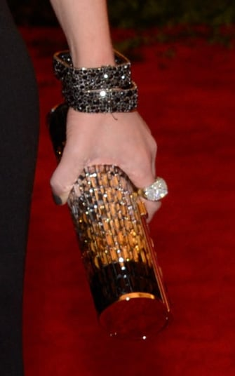 Emily Blunt wore Lorraine Schwartz jewels and carried a Jimmy Choo clutch.