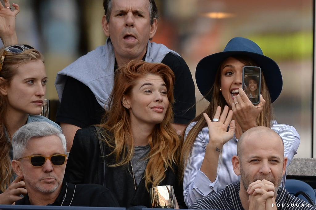 Jessica Alba excitedly captured a picture of herself and friends at the US Open in NYC in September 2013.