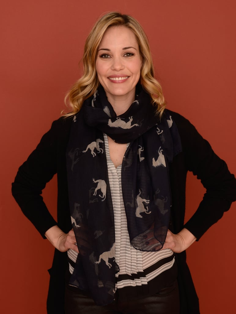 Leslie Bibb went print-on-print in a pleated striped blouse and horse-print scarf.