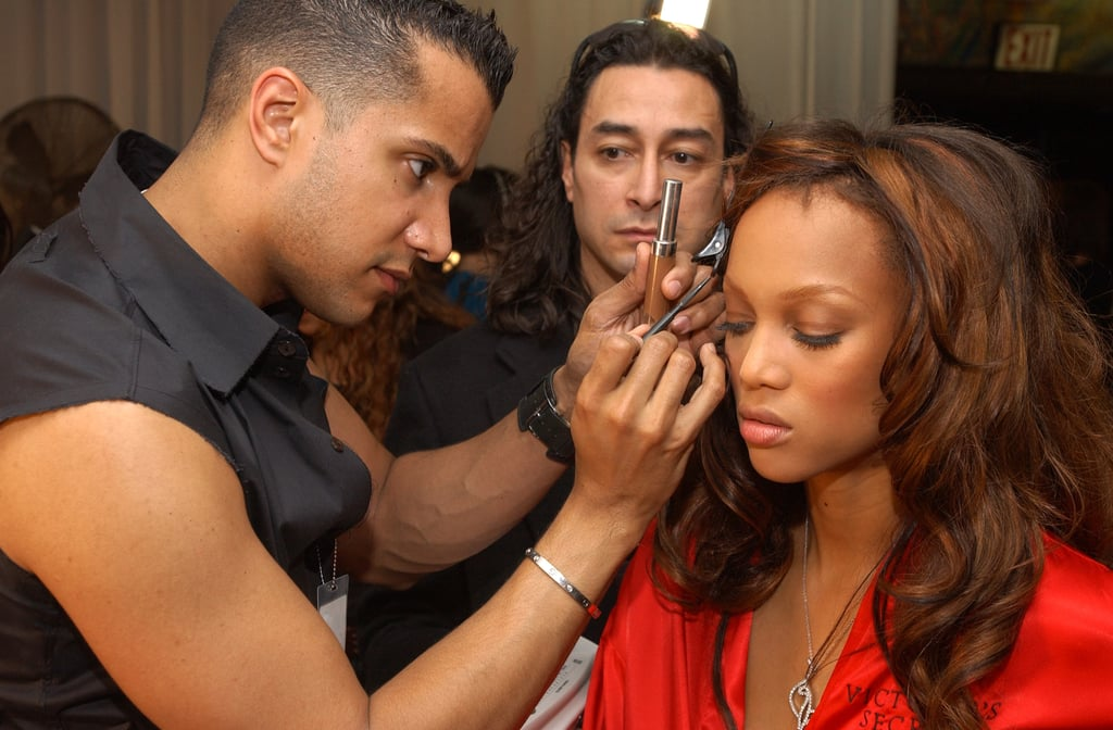 Jay Manuel touched up Tyra's makeup backstage in 2002.