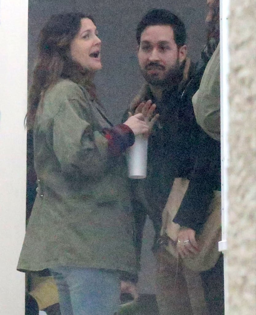 Drew Barrymore held an animated conversation with friends.