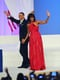 Michelle Obama stunned in a custom ruby chiffon and velvet gown by Jason Wu that reportedly features a custom diamond halter ring by Kimberly McDonald. The FLOTUS finished off her look with Jimmy Choo shoes.