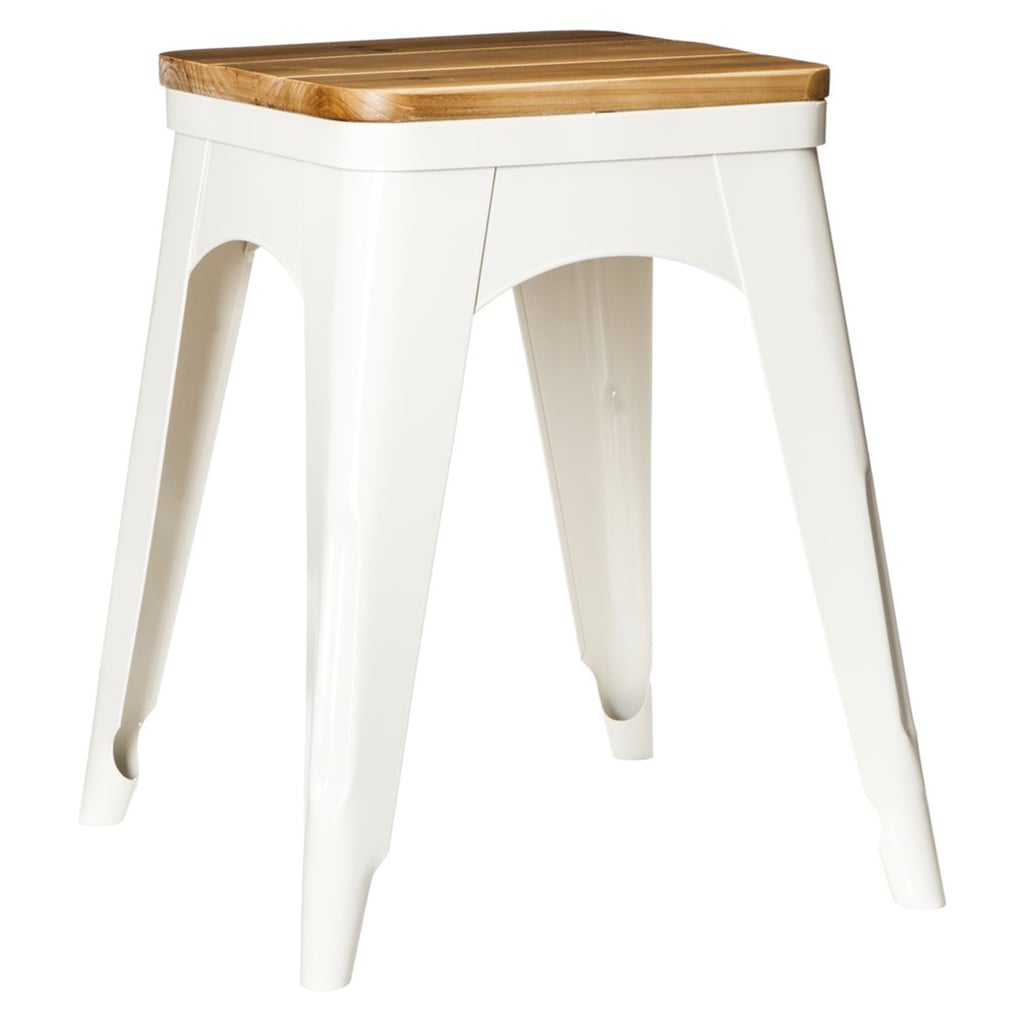 Offered in galvanized silver and white, this metal-and-wood stool ($50) could double as an end table.