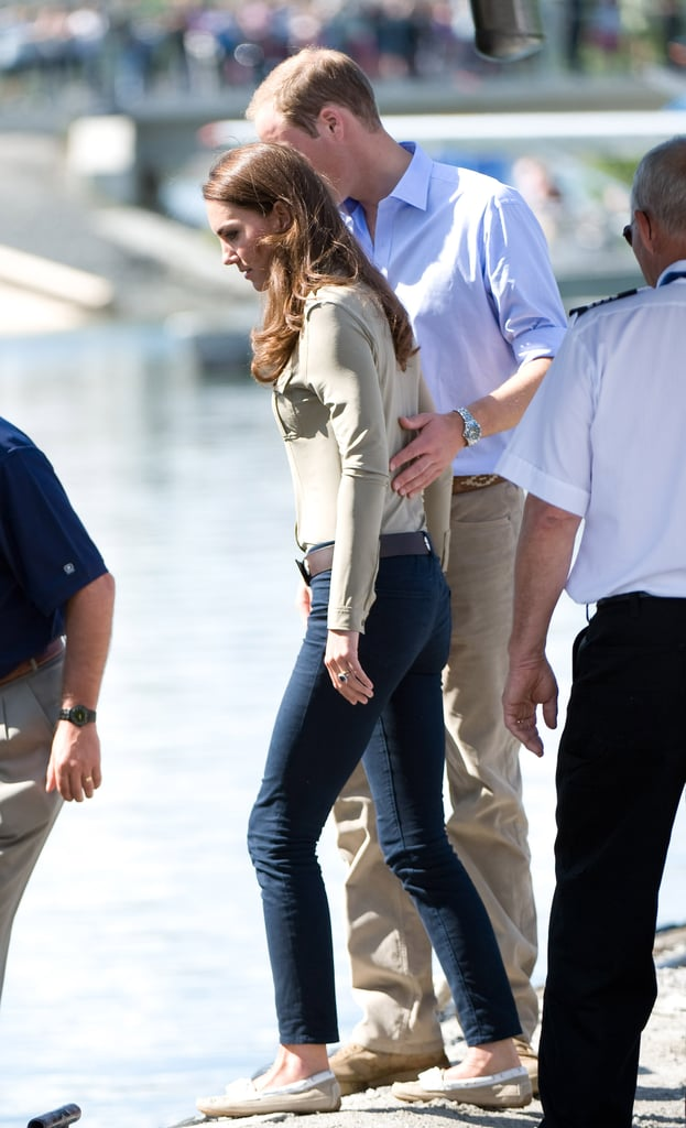 Prince William put a loving hand on Kate Middleton's back during a stop in Yellowknife, Canada, in July 2011.