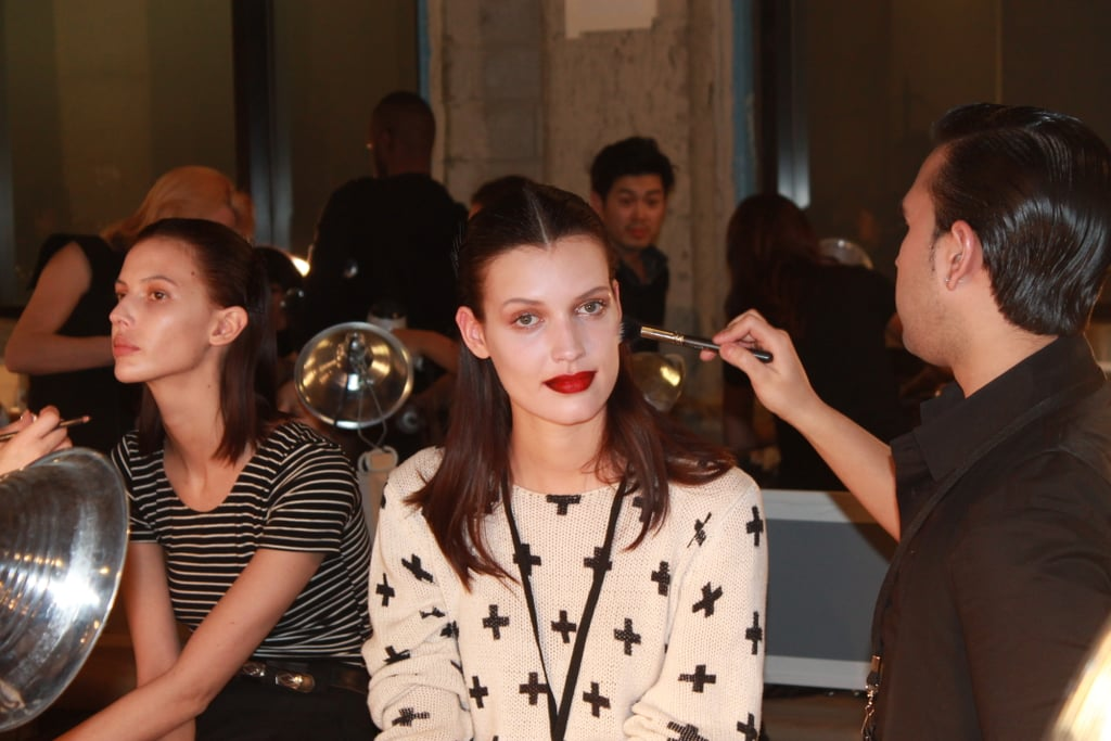 """The makeup look was focused around the ombré lips, which were lined in black and then diffused down to red. """"The inspiration was a New York urban girl, and we knew we wanted a bold lip,"""" MAC lead artist Romy Soleimani said. The matte lip played off the greasy, silvery eye. Photo: Maria Del Russo"""