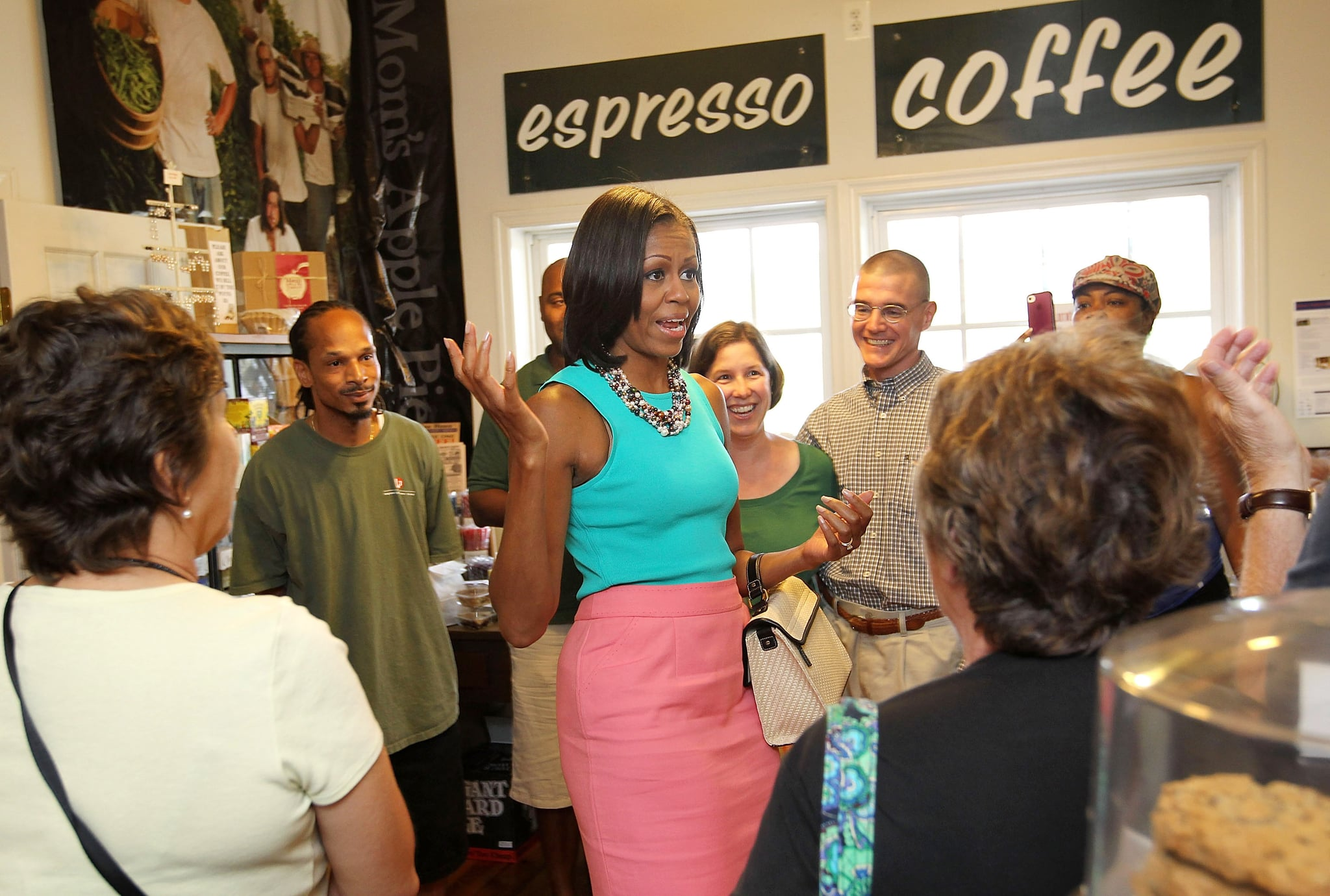 Michelle visited a bakery in Virginia wearing a spirited colorblock look. She tucked an Ann Taylor tank into a bright pink skirt and carried a Jason Wu for Target handbag. Talk about affordable fashion!