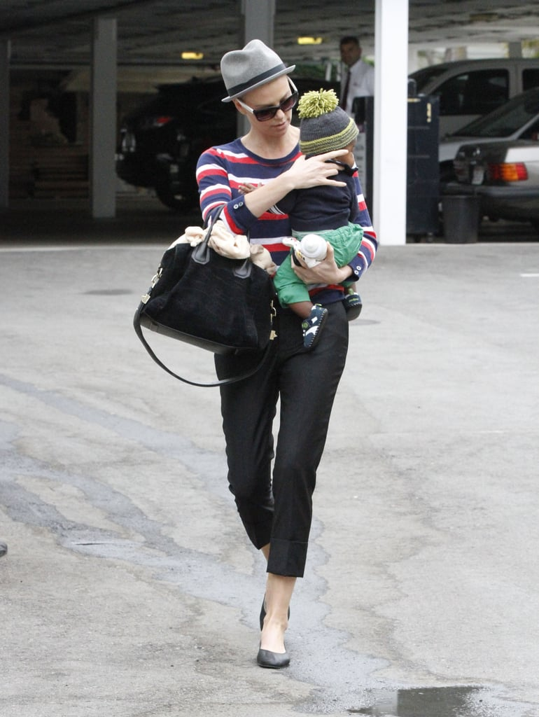 Charlize Theron pat Jackson on the back while running errands in Beverly Hills.