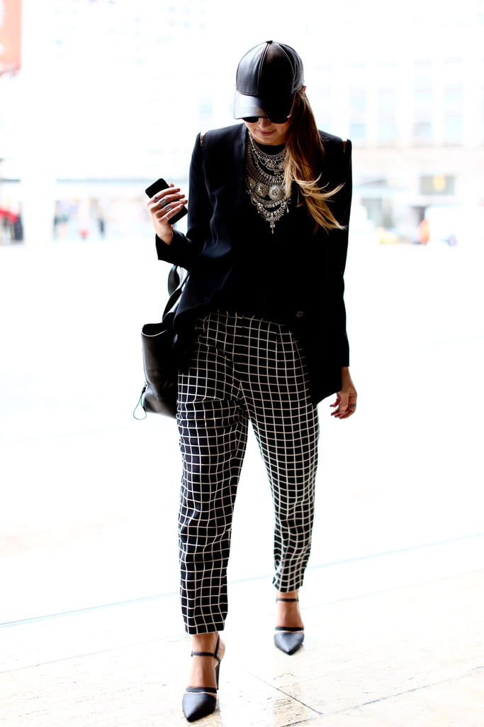 This attendee worked the window-pane trend in two-tone patterned trousers that also speak to the chic color palette.