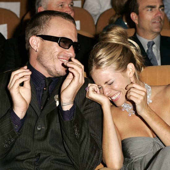Heath Ledger and Sienna Miller giggled inside the Palazzo del Cinema in 2005.