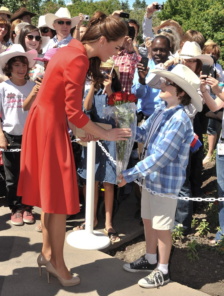 She was greeted by a cute little boy in a cowboy hat at the Calgary Zoo in July 2011.