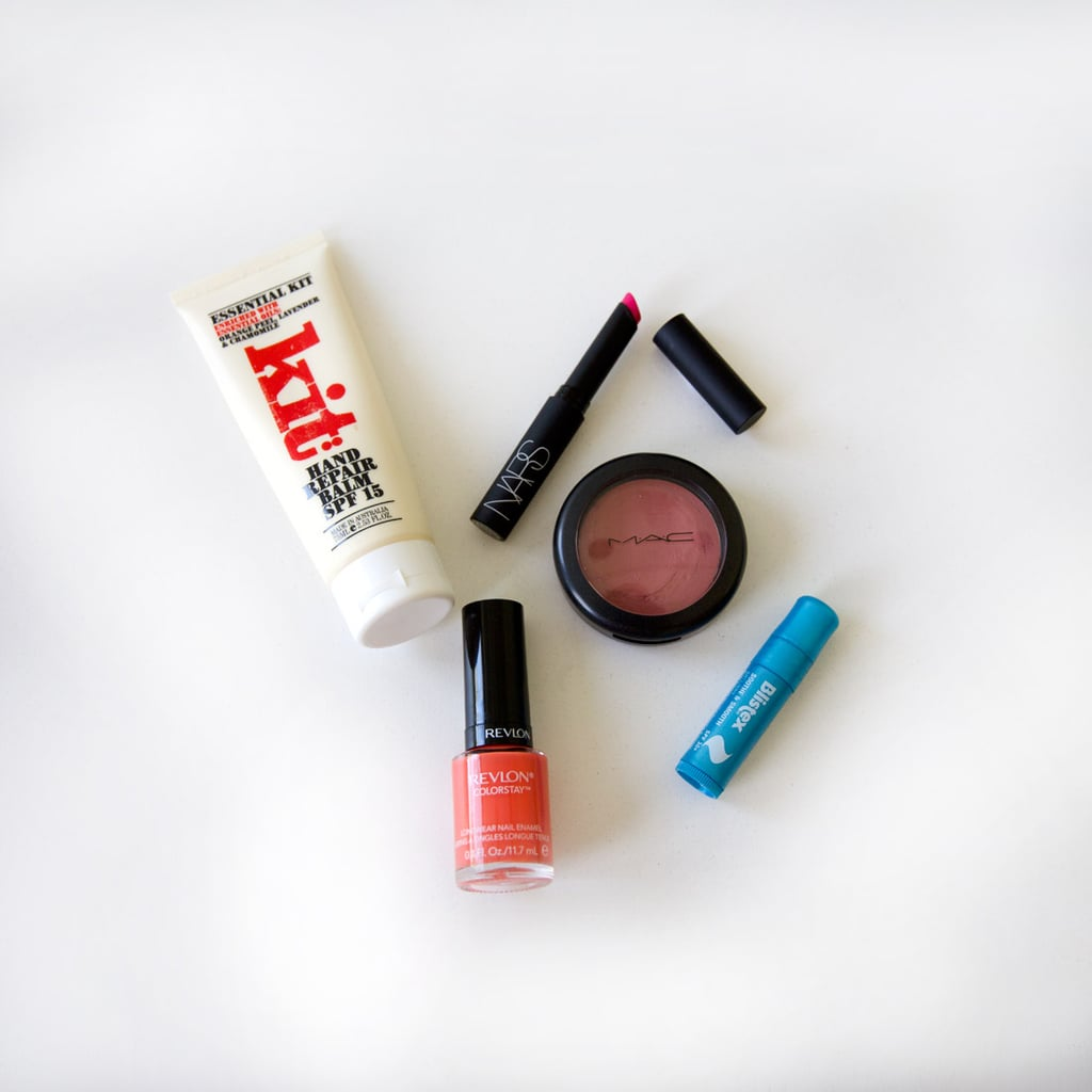 I don't carry around too much makeup, but I have enough for touch-ups after work for nighttime events. I'm obsessed with having painted nails so I carry around the shade I'm wearing to fix any chips. A bright lip colour is great for a pick-me-up after a full day of working, and I panic if I go anywhere without lip balm — maybe that's an overreaction, but I hate the thought of chapped lips.