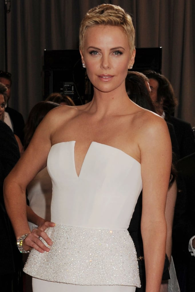 Charlize Theron will star in and produce an untitled crime film about a corrupt vigilante group.