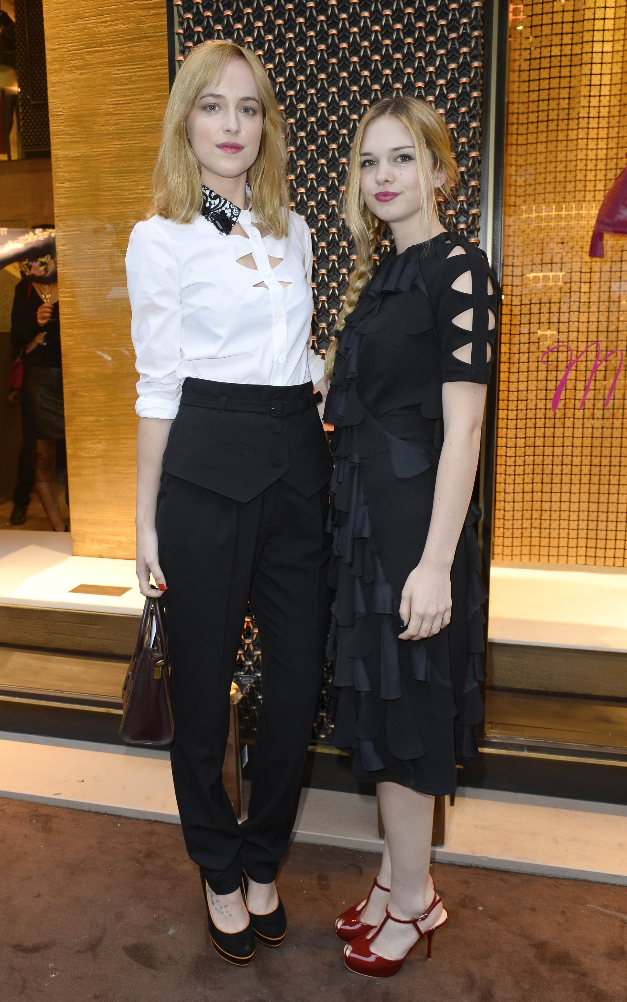 Dakota Johnson and Stella Banderas doubled up on the blond power at the Paris Loewe boutique opening. Source: Loewe
